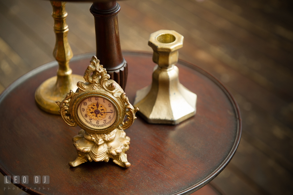 Old table clock from Vintage Affairs. Kent Island Maryland Chesapeake Bay Beach Club Bow Ties and Bubbly wedding show photos at the Tavern Bayside, by wedding photographers of Leo Dj Photography. http://leodjphoto.com