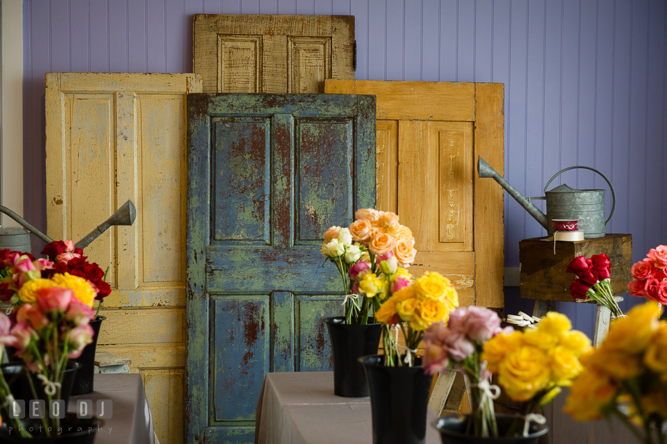 Old colorful doors from Vintage Affairs with roses in the foreground. Kent Island Maryland Chesapeake Bay Beach Club Bow Ties and Bubbly wedding show photos at the Tavern Bayside, by wedding photographers of Leo Dj Photography. http://leodjphoto.com