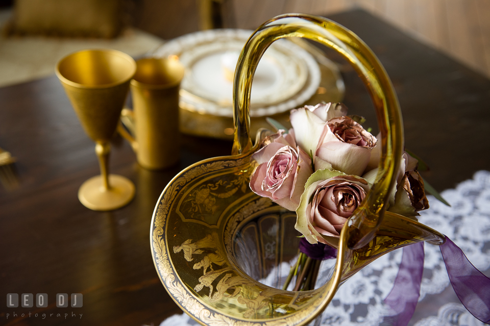 Pink roses in an antique glass basket from Vintage Affairs. Kent Island Maryland Chesapeake Bay Beach Club Bow Ties and Bubbly wedding show photos at the Tavern Bayside, by wedding photographers of Leo Dj Photography. http://leodjphoto.com