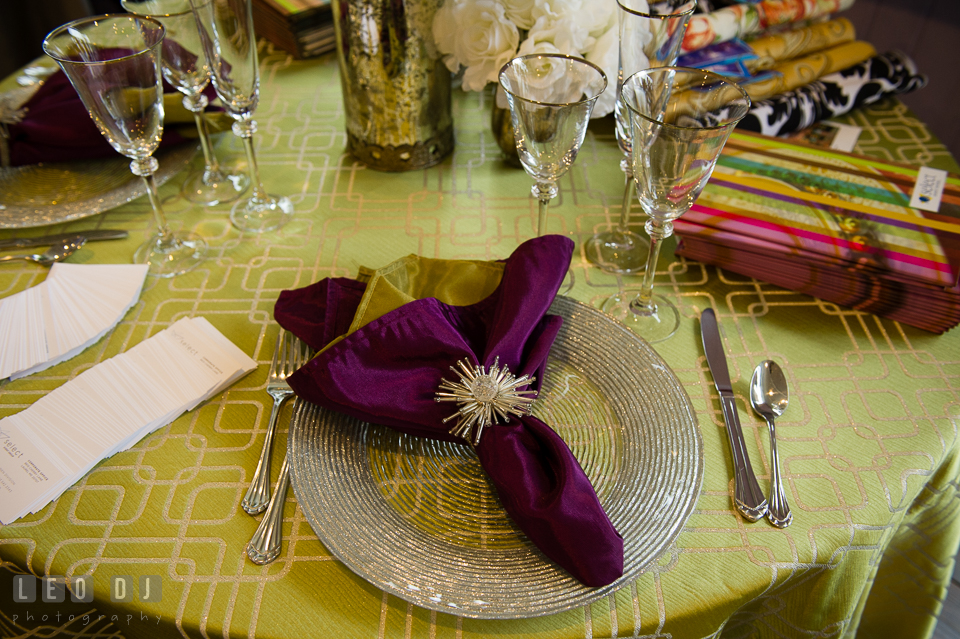 Table setup and purple napkin from Select Event Group. Kent Island Maryland Chesapeake Bay Beach Club Bow Ties and Bubbly wedding show photos at the Tavern Bayside, by wedding photographers of Leo Dj Photography. http://leodjphoto.com