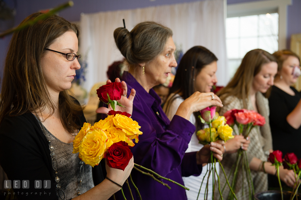 Attendees arranging flowers. Kent Island Maryland Chesapeake Bay Beach Club Bow Ties and Bubbly wedding show photos at the Tavern Bayside, by wedding photographers of Leo Dj Photography. http://leodjphoto.com