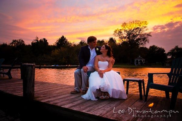 bride groom on pier dock with beautiful sunset annapolis kent island maryland wedding photography photographers