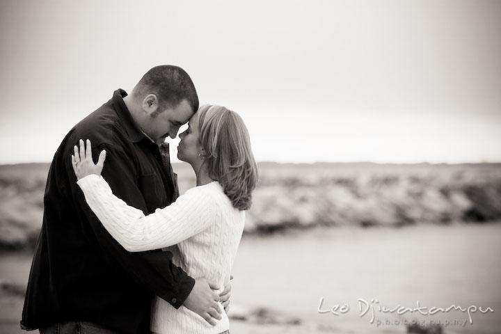 black and white picture of engaged couple hugging, guy, girl, fiancee. Engagement Photographer Matapeake Beach, Chesapeake Bay