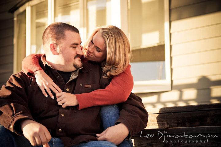 engaged girl hugged her fiancee guy, smiling. Engagement Photographer Matapeake Beach, Chesapeake Bay