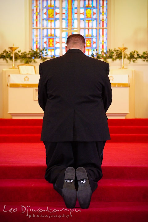 Groom praying in front of the altar. Kent Island Methodist Church KIUMC Wedding Photographer Maryland