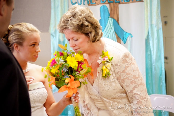 Bride asked her mother to smell the nice flower bouquet. Kent Island Methodist Church KIUMC Wedding Photographer Maryland