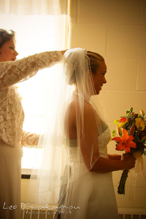 Mother of bride putting on veil for her daughter. Kent Island Methodist Church KIUMC Wedding Photographer Maryland