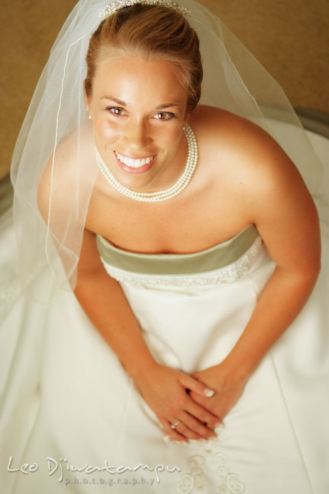 Beautiful bride on her wedding dress, looking up, smiling. Kent Island Methodist Church KIUMC Wedding Photographer Maryland
