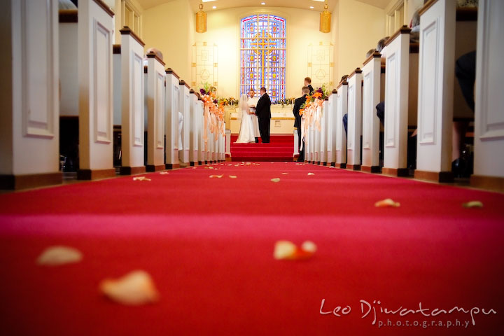 Church isle with flower petals on the carpet. Kent Island Methodist Church KIUMC Wedding Photographer Maryland