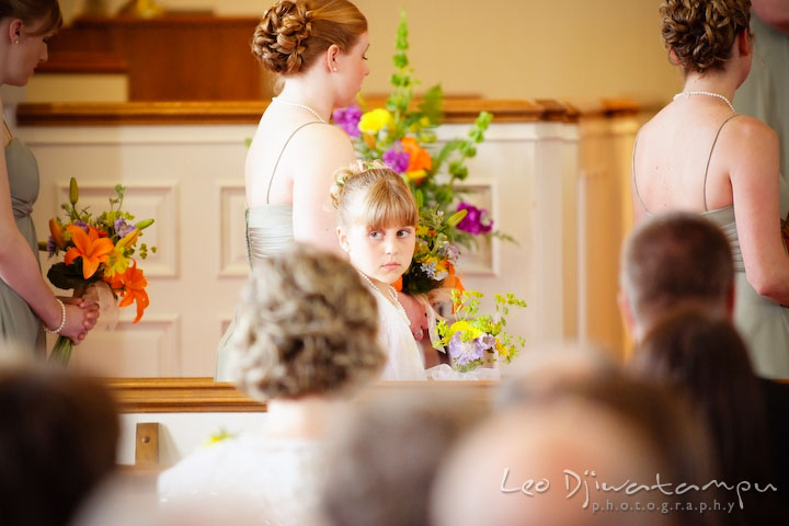 Flower girl, with bridesmaids on the background. Kent Island Methodist Church KIUMC Wedding Photographer Maryland