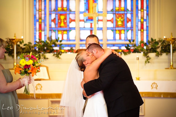 Groom hugging bride after they are official. Kent Island Methodist Church KIUMC Wedding Photographer Maryland
