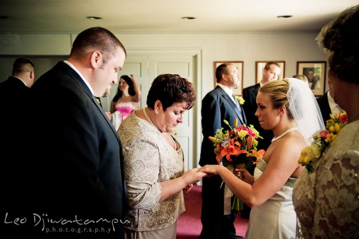 Mother of groom checking out bride's wedding ring. Kent Island Methodist Church KIUMC Wedding Photographer Maryland