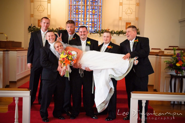 Groom, best man, and groomsman lifting up bride. Kent Island Methodist Church KIUMC Wedding Photographer Maryland