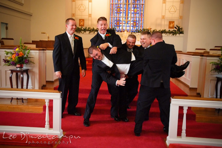 Best man and groomsman trying to lift up groom, and groom almost fell. Kent Island Methodist Church KIUMC Wedding Photographer Maryland