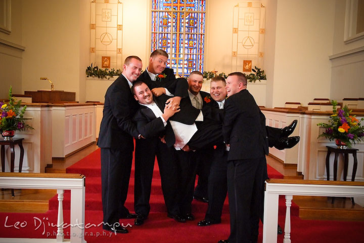 Best man and groomsman succesfully lift up groom. Kent Island Methodist Church KIUMC Wedding Photographer Maryland