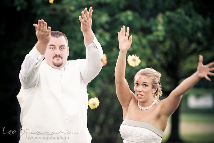 Bride and groom tossing flowers. Kent Island Flowers MD American Legion Wedding Photographer