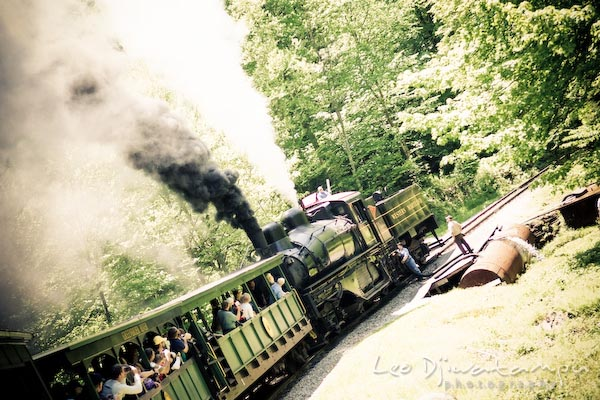 engineers fill up train locomotive with water to power the steam engine
