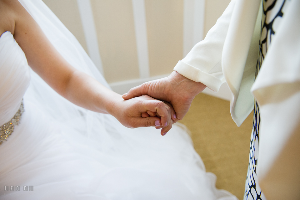 Chesapeake Bay Beach Club Mother of the Bride holding her daughter's hand photo by Leo Dj Photography
