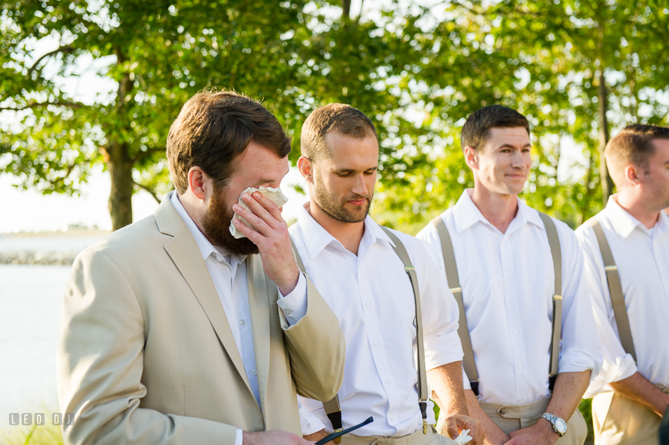 Chesapeake Bay Beach Club Groom crying seeing Bride for the first time during processional photo by Leo Dj Photography