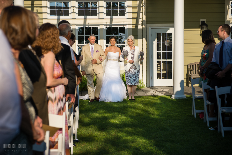 Chesapeake Bay Beach Club Bride walking down the aisle escorted by Father and Mother photo by Leo Dj Photography