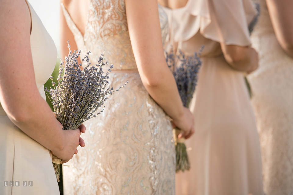 Chesapeake Bay Beach Club Groom bridesmaids holding lavender floral bouquets during ceremony photo by Leo Dj Photography