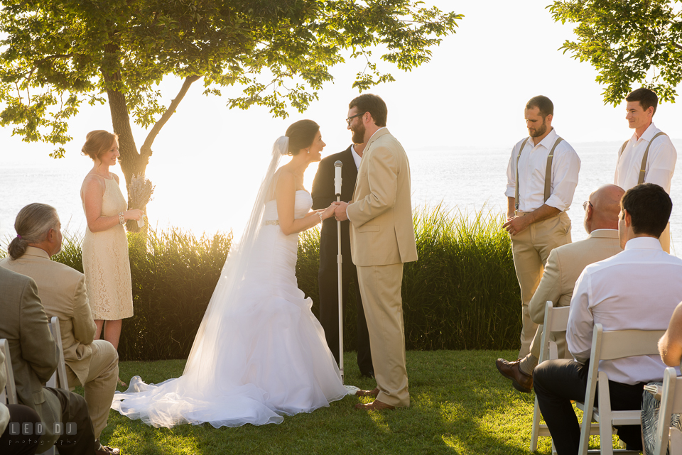 Eastern Shore Maryland Bride and Groom laughing reciting the vow during ceremony photo by Leo Dj Photography
