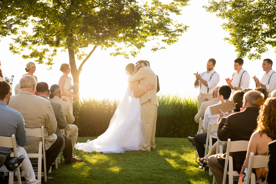 Chesapeake Bay Beach Club first kiss of Bride and Groom during the ceremony photo by Leo Dj Photography