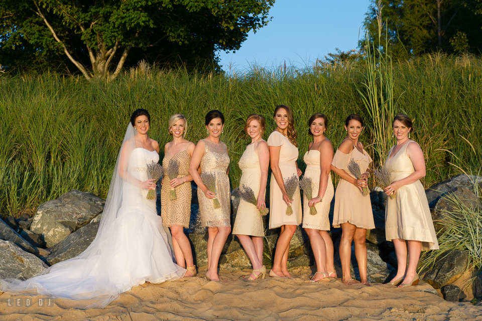 Chesapeake Bay Beach Club Bride with Bridal party posing on the beach photo by Leo Dj Photography