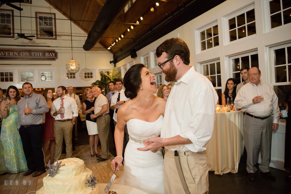 Chesapeake Bay Beach Club Bride and Groom laughin while cutting cake photo by Leo Dj Photography