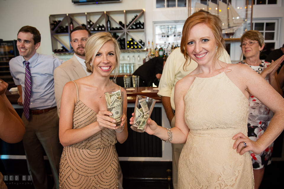Chesapeake Bay Beach Club Bridesmaids showing the catch of the day from money dance photo by Leo Dj Photography
