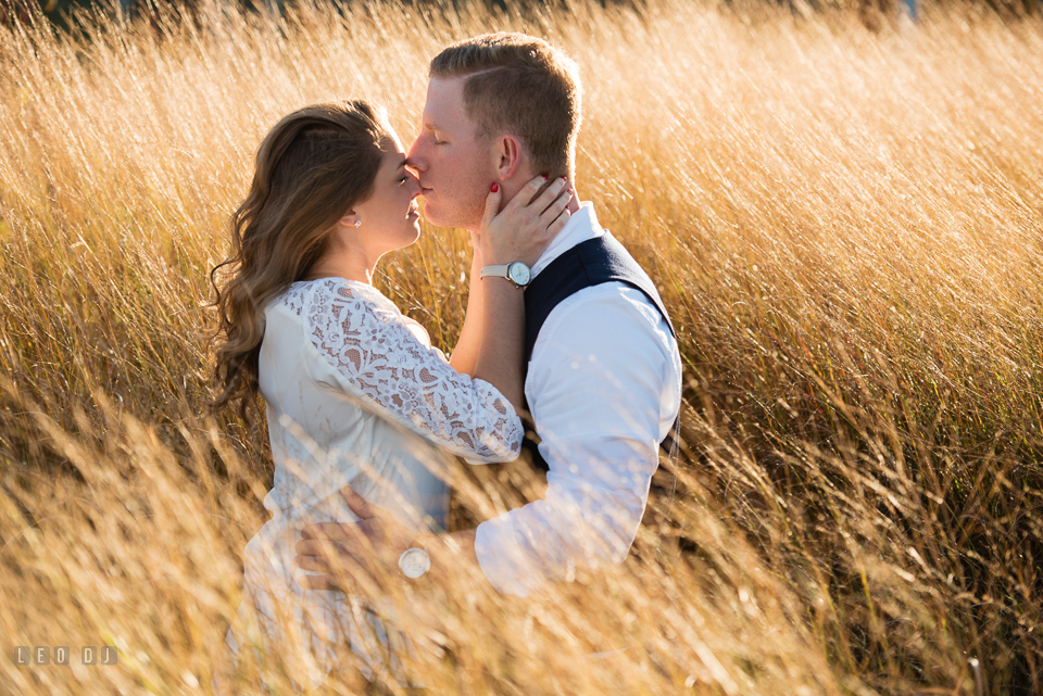 Cape Henlopen Lewes Delaware engaged couple kissing photo by Leo Dj Photography.