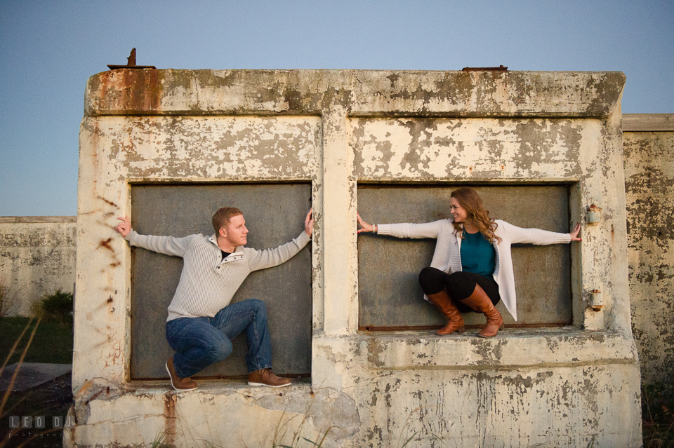 Cape Henlopen State Park Delaware engaged man and his fiancee at abandoned building during engagement photo by Leo Dj Photography.