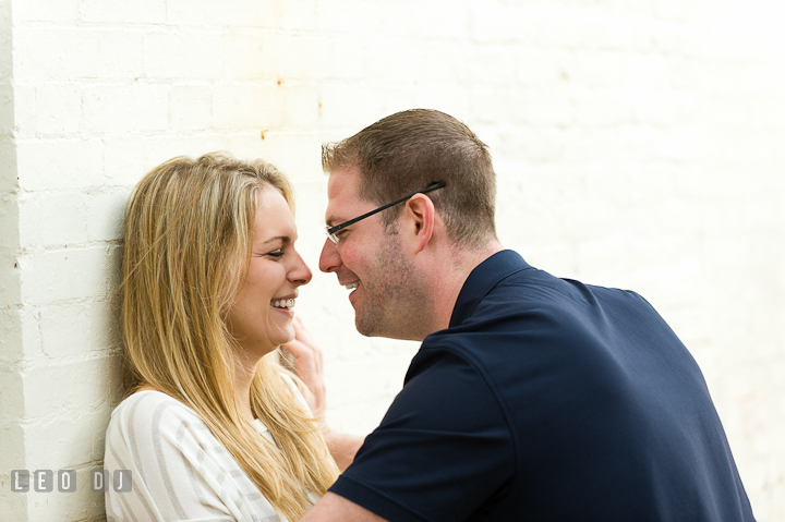 Engaged couple laughing together. Pre-wedding engagement photo session at Annapolis city downtown harbor, Maryland, Eastern Shore, by wedding photographers of Leo Dj Photography. http://leodjphoto.com