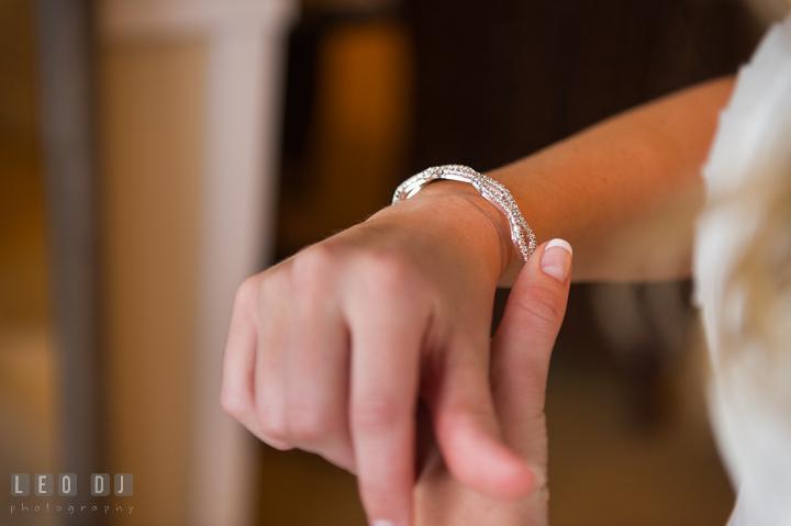 Bride putting on diamond bracelet on her wrist. Kent Island Maryland Chesapeake Bay Beach Club wedding ceremony and getting ready photo, by wedding photographers of Leo Dj Photography. http://leodjphoto.com