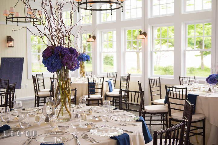 Purple, violet and blue hydrangeas table centerpiece by Cache Fleur. Kent Island Maryland Chesapeake Bay Beach Club wedding reception party photo, by wedding photographers of Leo Dj Photography. http://leodjphoto.com