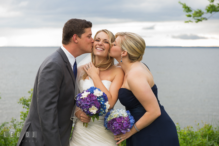Bride kissed by Brother and Maid of Honor. Kent Island Maryland Chesapeake Bay Beach Club wedding reception party photo, by wedding photographers of Leo Dj Photography. http://leodjphoto.com