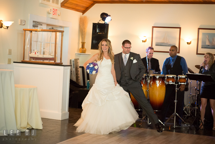 Bride and Groom introduced by the MC from Onyx Band entering the Tavern Ballroom. Kent Island Maryland Chesapeake Bay Beach Club wedding reception party photo, by wedding photographers of Leo Dj Photography. http://leodjphoto.com