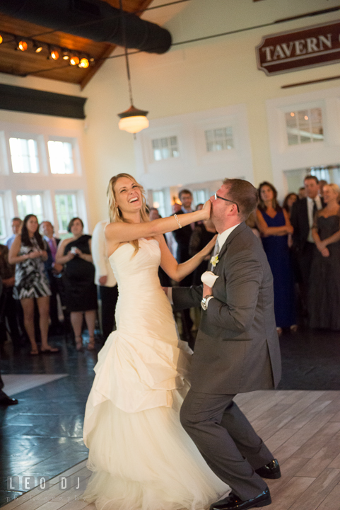 Bride covering Grooms mouth while performing their first dance. Kent Island Maryland Chesapeake Bay Beach Club wedding reception party photo, by wedding photographers of Leo Dj Photography. http://leodjphoto.com
