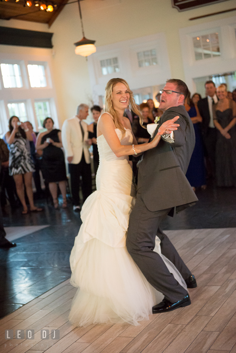 Groom doing silly dance while doing first dance with Bride. Kent Island Maryland Chesapeake Bay Beach Club wedding reception party photo, by wedding photographers of Leo Dj Photography. http://leodjphoto.com