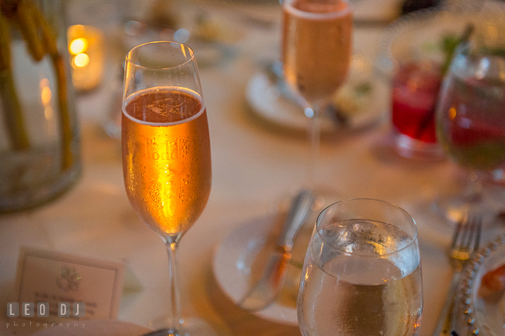 Bride and Groom's name engraved on their champagne glasses. Kent Island Maryland Chesapeake Bay Beach Club wedding reception party photo, by wedding photographers of Leo Dj Photography. http://leodjphoto.com