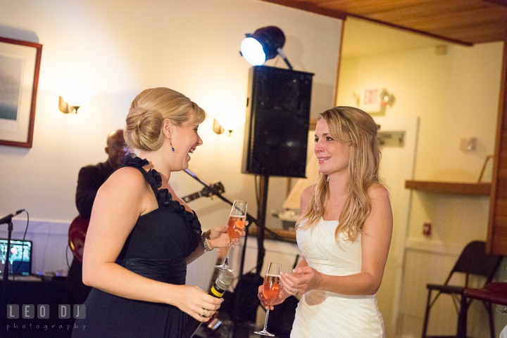 Bride gets teary eyed after Maid of Honor's toast speech. Kent Island Maryland Chesapeake Bay Beach Club wedding reception party photo, by wedding photographers of Leo Dj Photography. http://leodjphoto.com