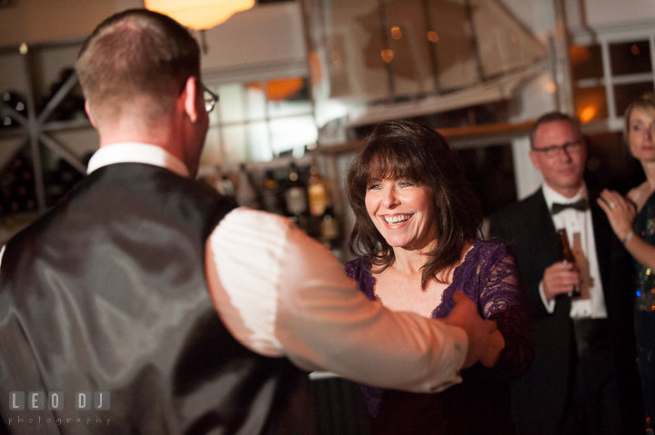 Mother of Groom laughing while dancing with son. Kent Island Maryland Chesapeake Bay Beach Club wedding reception party photo, by wedding photographers of Leo Dj Photography. http://leodjphoto.com