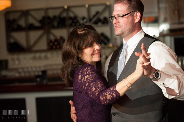 Groom dancing with Mother during parent dance. Kent Island Maryland Chesapeake Bay Beach Club wedding reception party photo, by wedding photographers of Leo Dj Photography. http://leodjphoto.com