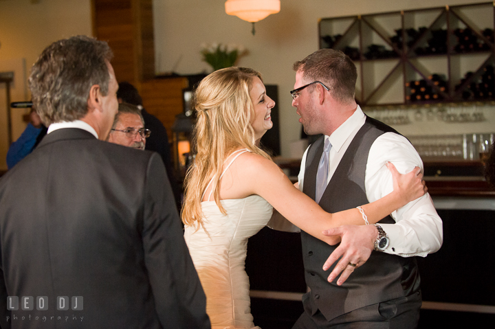 Bride holding Groom to stop his silliness. Kent Island Maryland Chesapeake Bay Beach Club wedding reception party photo, by wedding photographers of Leo Dj Photography. http://leodjphoto.com