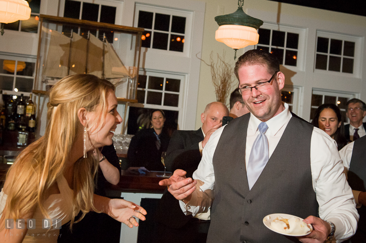 Groom realized that Bride was playing prank on him. Kent Island Maryland Chesapeake Bay Beach Club wedding reception party photo, by wedding photographers of Leo Dj Photography. http://leodjphoto.com
