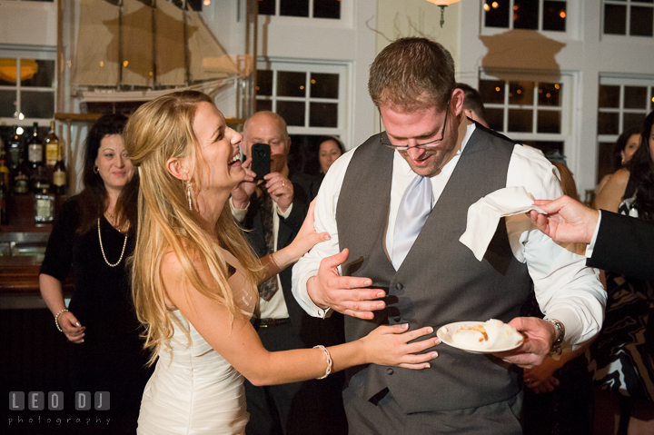 Bride laughing hard after her prank on Groom. Kent Island Maryland Chesapeake Bay Beach Club wedding reception party photo, by wedding photographers of Leo Dj Photography. http://leodjphoto.com