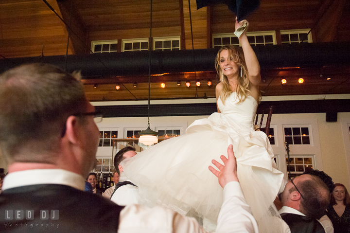 Bride still up in the air on her chair and Groom asked her to come down. Kent Island Maryland Chesapeake Bay Beach Club wedding reception party photo, by wedding photographers of Leo Dj Photography. http://leodjphoto.com