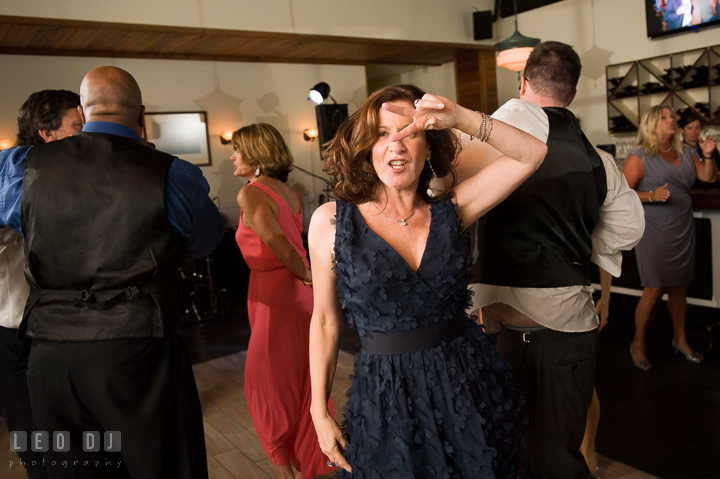 One lady guest doing the pulp fiction dance. Kent Island Maryland Chesapeake Bay Beach Club wedding reception party photo, by wedding photographers of Leo Dj Photography. http://leodjphoto.com