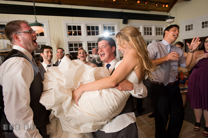 Bride's Brother lifted up and carried his sister. Kent Island Maryland Chesapeake Bay Beach Club wedding reception party photo, by wedding photographers of Leo Dj Photography. http://leodjphoto.com