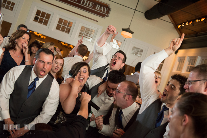 Guests passionately singing along with the band. Kent Island Maryland Chesapeake Bay Beach Club wedding reception party photo, by wedding photographers of Leo Dj Photography. http://leodjphoto.com